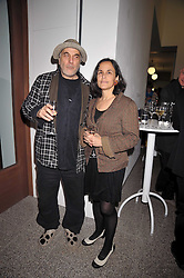RON ARAD and his wife at a party to celebrate the opening of the new Whitechapel Gallery, 77-82 Whitechapel High Street, London E1 on 2nd April 2009.