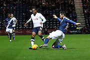 Preston North End Midfielder Daniel Johnson battles with Birmingham City defender Jonathan Grounds  during the Sky Bet Championship match between Preston North End and Birmingham City at Deepdale, Preston, England on 15 December 2015. Photo by Pete Burns.