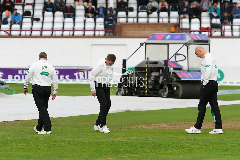 The umpires on the field for an inspection as play is delayed after heavy overnight rain during the Specsavers County Champ Div 1 match between Somerset County Cricket Club and Essex County Cricket Club at the Cooper Associates County Ground, Taunton, United Kingdom on 25 September 2019.