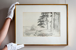"© Licensed to London News Pictures. 31/05/2018. LONDON, UK. A gallery technician presents ""...an enchanted place on the very top of the forest, 1928, by E.H. Shephard (Est. GBP70,000-90-000), which will be offered for sale at Sotheby's in New Bond Street at the English Literature, History, Science, Children's Books and Illustrations sale on 10 July. A.A. Milne's much loved characters from the Winnie-the-Pooh books inhabited the Hundred Acre Wood.  Photo credit: Stephen Chung/LNP"