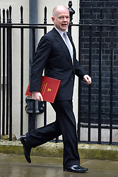 © Licensed to London News Pictures. 20/03/2013. Westminster, UK. William Hague, Conservative MP, Secretary of State for Foreign and Commonwealth Affairs.   ..Chancellor Of The Exchequer George Osborne poses for photographers whilst holding his red ministerial box outside 11 Downing Street In London, before presenting his annual budget to parliament today 20th March 2013. Photo credit : Stephen Simpson/LNP