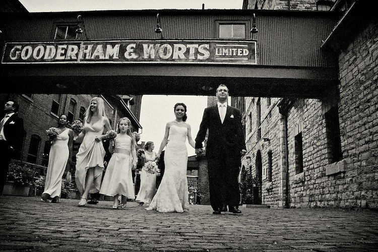 Newlyweds and their bridal party enjoy a stroll through the Distillery District, Toronto. To view Myriam and Cory's complete Wedding Gallery Collection, please visit the Client Area and log-in. You'll be able to view these and other images as a slideshow, order prints and more.<br />