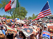 May 29 - PHOENIX, AZ: American and Mexican flags at a pro-immigrants rally in Phoenix, AZ, Saturday. More than 30,000 people, supporters of immigrants' rights and opposed to Arizona SB1070, marched through central Phoenix to the Arizona State Capitol Saturday. SB1070 makes it an Arizona state crime to be in the US illegally and requires that immigrants carry papers with them at all times and present to law enforcement when asked to. Critics of the law say it will lead to racial profiling, harassment of Hispanics and usurps the federal role in immigration enforcement. Supporters of the law say it merely brings Arizona law into line with existing federal laws.  Photo by Jack Kurtz