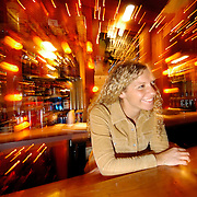 Marcellus, NY / 2004 - Joanna Traino, bartender at the Village Tavern in Marcellus jokes with a patron from across the bar early Saturday afternoon while taking a drink order. Photo by Mike Roy