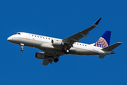 United Express Embraer ERJ170-200LR (registration N150SY) approaches San Francisco International Airport (SFO) over San Mateo, California, United States of America