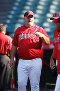 ANAHEIM, CA - AUGUST 18:  Manager Mike Scioscia #14 of the Los Angeles Angels of Anaheim shares a laugh during batting practice during the game against the Texas Rangers on August 18, 2011 at Angel Stadium in Anaheim, California. The Angels won the game 2-1. (Photo by Paul Spinelli/MLB Photos via Getty Images) *** Local Caption *** Mike Scioscia