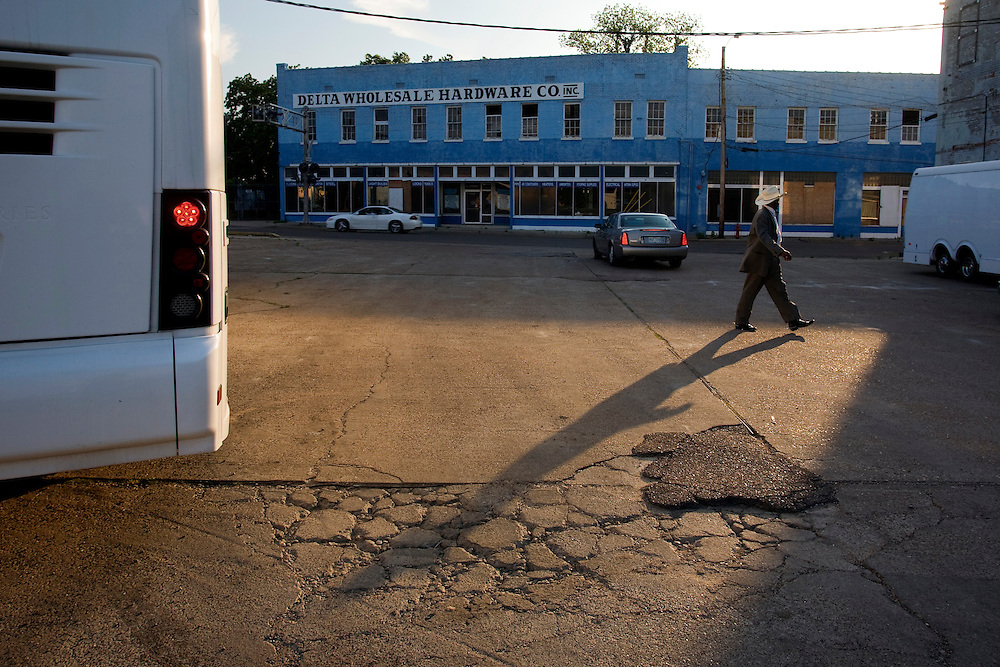 A member of Big George Brock's band strolls across the parking lot of the Ground Zero Blues Club in Clarksdale, Miss., 2007.