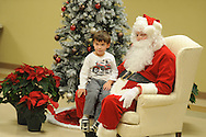 Alex Leake visits with Santa Claus during Family Crisis Services' Milk and Cookies with Santa in Oxford, Miss. on Thursday, December 5, 2013. Addy Photography provided photography of the event.