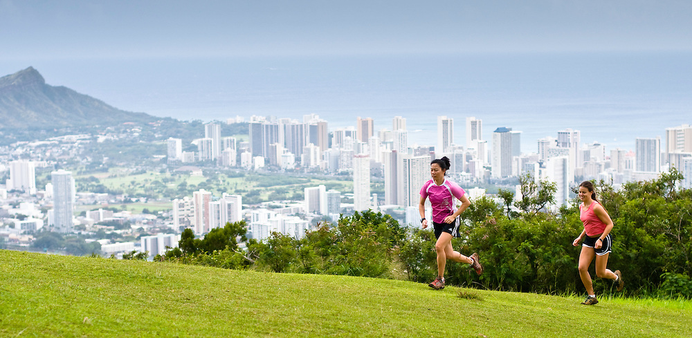 Julie Ng and Cindy Gibson escape the hustle and bustle of Waikiki for an afternoon run on the Tantalus trail system.  Honolulu, HI.