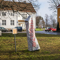 Runestone in Søgne with wintercoat.