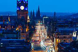 Edinburgh, Scotland, UK. 7 April 2020. Evening view of Princes Street in Edinburgh during the coronavirus lockdown which has dramatically reduced traffic volumes on the street. Long exposure image shows very little traffic. Iain Masterton/Alamy Live News
