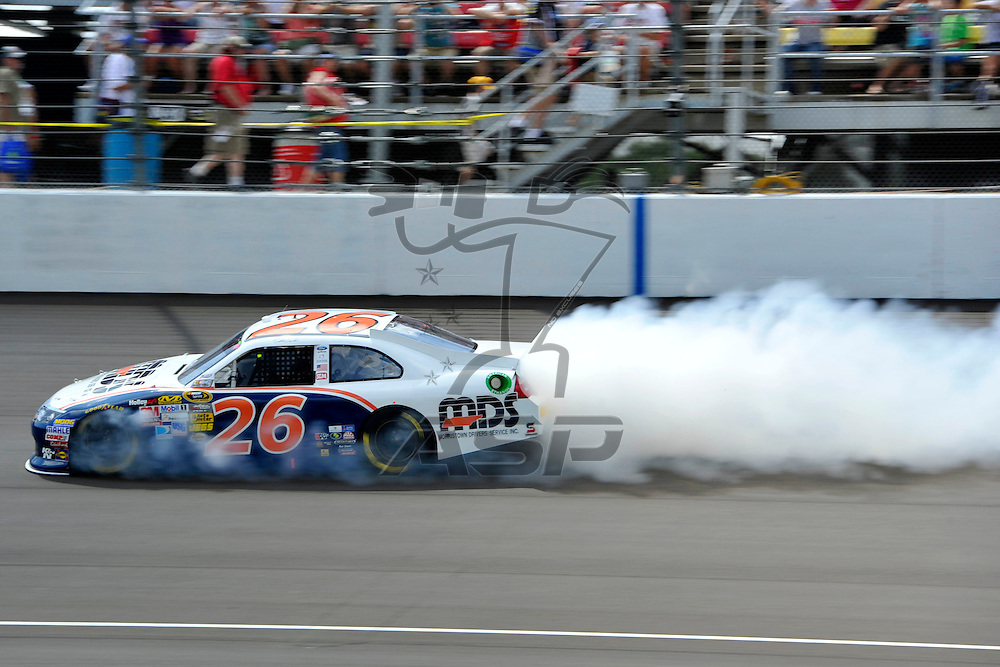 Brooklyn, MI - JUN 17, 2012: Josh Wise (26) blows a motor during race action for the Quicken Loans 400 race at the Michigan International Speedway in Brooklyn, MI.