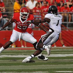 Sep 7, 2009; Piscataway, NJ, USA; Rutgers cornerback Zaire Kitchen (29) tracks Cincinnati wide receiver Marshwan Gilyard (1) during the first half of Rutgers game against Cincinnati in NCAA college football at Rutgers Stadium.