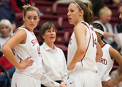 November 1, 2009; Stanford, CA, USA;  Stanford Cardinal head coach Tara VanDerveer talks with forward Joslyn Tinkle (44) and forward Kayla Pedersen (14) during the second half against the Vanguard Lions at Maples Pavilion.  Stanford defeated Vanguard 107-49.