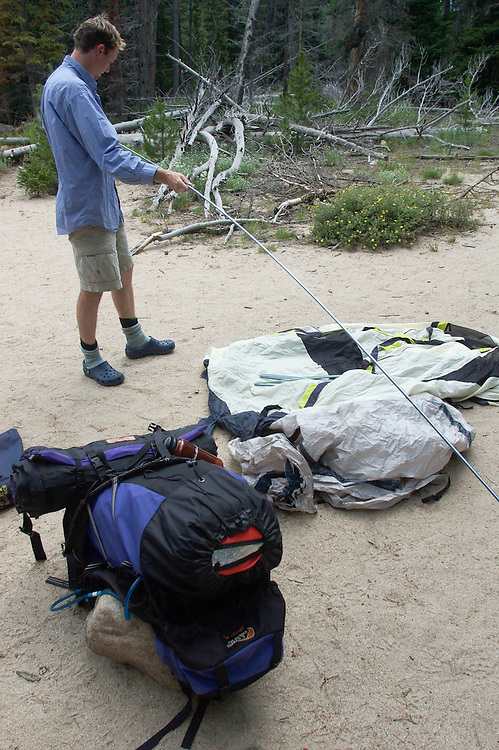 A hiker sets up camp in Rocky Mountain National Park.