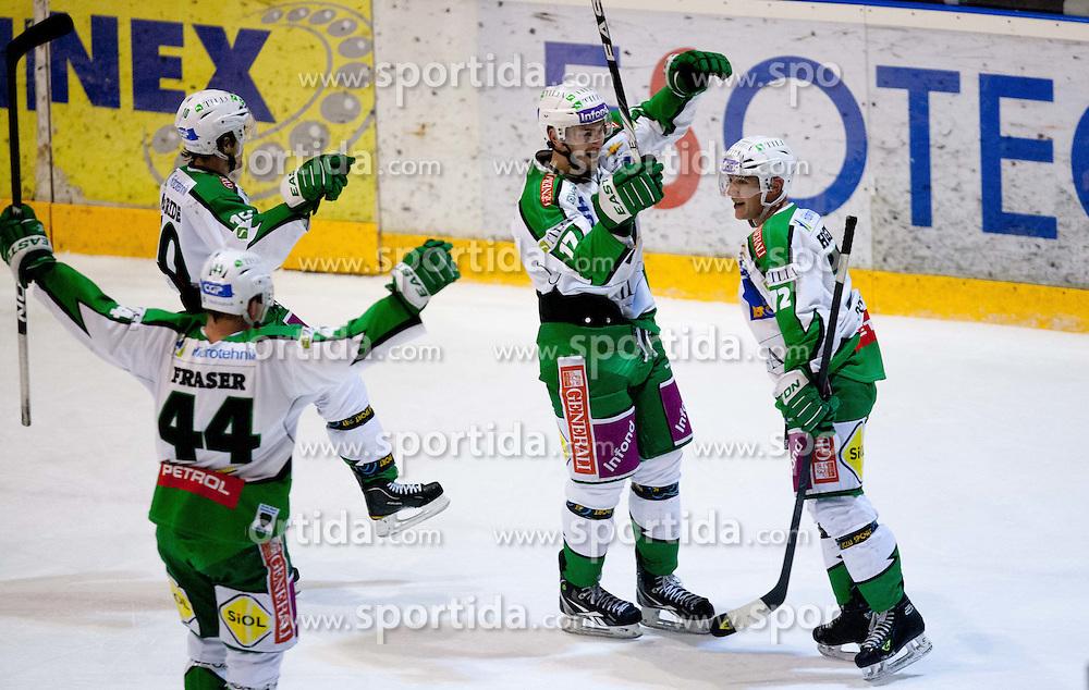 Players of Tilia Olimpija celebrate during ice-hockey match between HK Acroni Jesenice and HDD Tilia Olimpija of 34th Round of EBEL League 2011/2012, on December 26, 2011 in Arena Podmezakla, Jesenice, Slovenia. (Photo By Vid Ponikvar / Sportida.com)