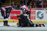 KELOWNA, CANADA - OCTOBER 21: Carsen Twarynski #18 and James Porter #1 stands over Athletic Therapist Scott Hoyer as he tends to James Hilsendager #2 of the Kelowna Rockets on the ice against the Portland Winterhawks on October 21, 2017 at Prospera Place in Kelowna, British Columbia, Canada.  (Photo by Marissa Baecker/Shoot the Breeze)  *** Local Caption ***