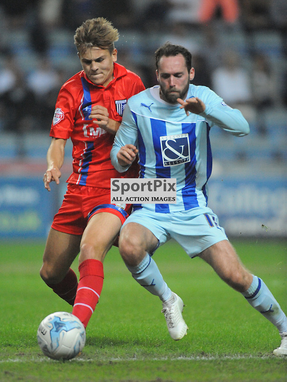 Coventrys Jim obrien Battles with Gillinghams Jake Hessenthaler,Coventry City v Gillingham, League One, Back at the Ricoh Stadium for First Time, after playing at Six Fields Northampton.<br /> Friday 5th September 2014
