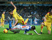 Tom Lawrence (Blackburn Wanderers) up-ended by Grant Ward (Rotherham United) just outside the box during the Sky Bet Championship match between Blackburn Rovers and Rotherham United at Ewood Park, Blackburn, England on 11 December 2015. Photo by Mark P Doherty.