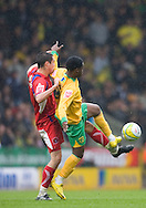 Norwich City - Saturday May 8 2010: of Norwich City's Anthony McNamee plays off Carlisle's Ben Marshall during match at Carrow Road, Norwich. (Pic by Rob Colman Focus Images)