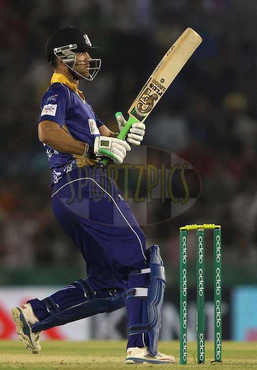 James Franklin of the Barbados Tridents looks back after pulling a delivery behind during match 5 of the Oppo Champions League Twenty20 between the Kings XI Punjab and the Barbados Tridents held at the Punjab Cricket Association Stadium, Mohali, India on the 20th September 2014<br /> <br /> Photo by:  Shaun Roy / Sportzpics/ CLT20<br /> <br /> <br /> Image use is subject to the terms and conditions as laid out by the BCCI/ CLT20.  The terms and conditions can be downloaded here:<br /> <br /> http://sportzpics.photoshelter.com/gallery/CLT20-Image-Terms-and-Conditions-2014/G0000IfNJn535VPU/C0000QhhKadWcjYs