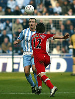 Photo: Chris Ratcliffe.<br />Coventry City v Middlesbrough. The FA Cup. 28/01/2006.<br />James Snowcroft (L) of Coventry beats Emmanuel Pogatez of Boro to the ball.