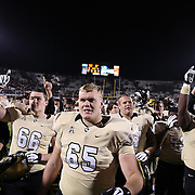 The UCF Knights football team walks off the field after defeating the South Florida Bulls by a score on 23-20 at Bright House Networks Stadium on Friday, November 29, 2013 in Orlando, Florida. (AP Photo/Alex Menendez)