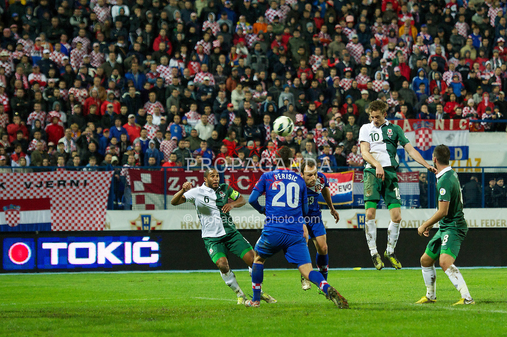 OSIJEK, CROATIA - Tuesday, October 16, 2012: Wales' Andy King sees his header saved against Croatia during the Brazil 2014 FIFA World Cup Qualifying Group A match at the Stadion Gradski Vrt. (Pic by David Rawcliffe/Propaganda)