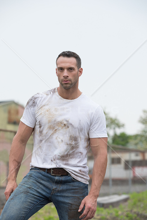 rugged guy in a dirty tee shirt