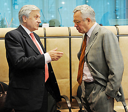 Jean-Claude Trichet, president of the European Central Bank, left, speaks with Giulio Tremonti, Italy's finance minister, during the Eurogroup meeting at EU headquarters in Brussels, Monday, July 6, 2009. (Photo © Jock Fistick)