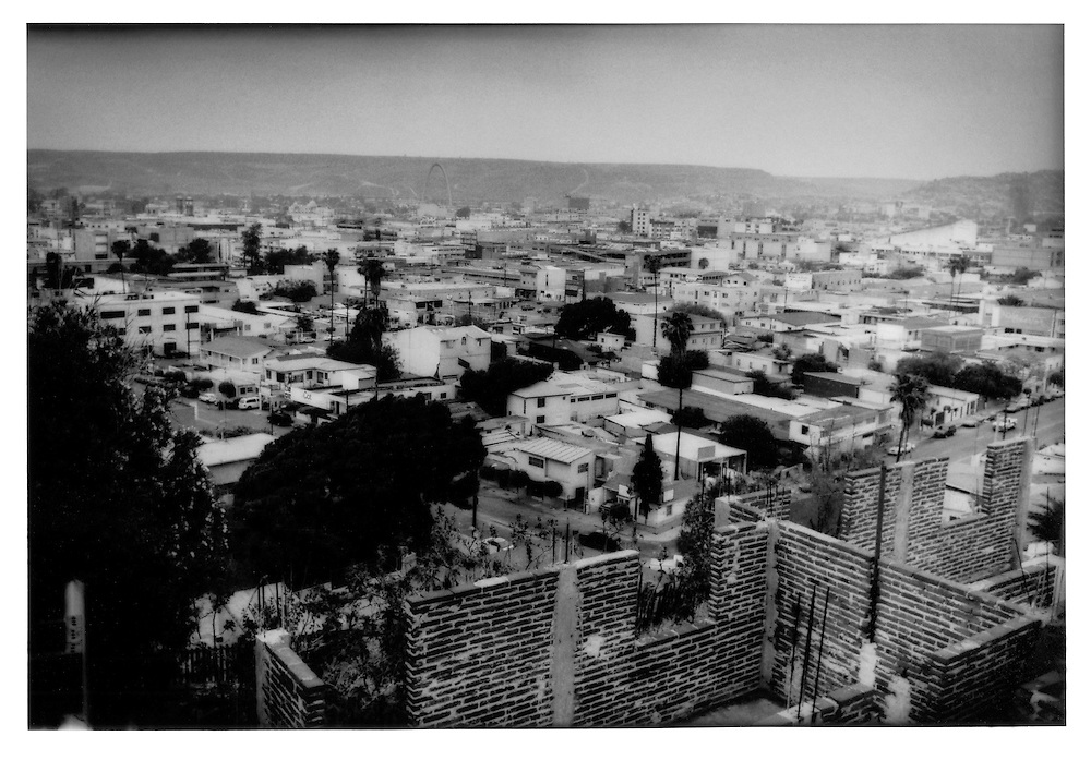 Central Tijuana, urban and dry, spreads toward Otay Mesa, in the background, which sits on the US side of the border, Tijuana, Baja California, Mexico.    Tijuana does not possess as much water as San Diego, California and more reflects the natural climate of the region.