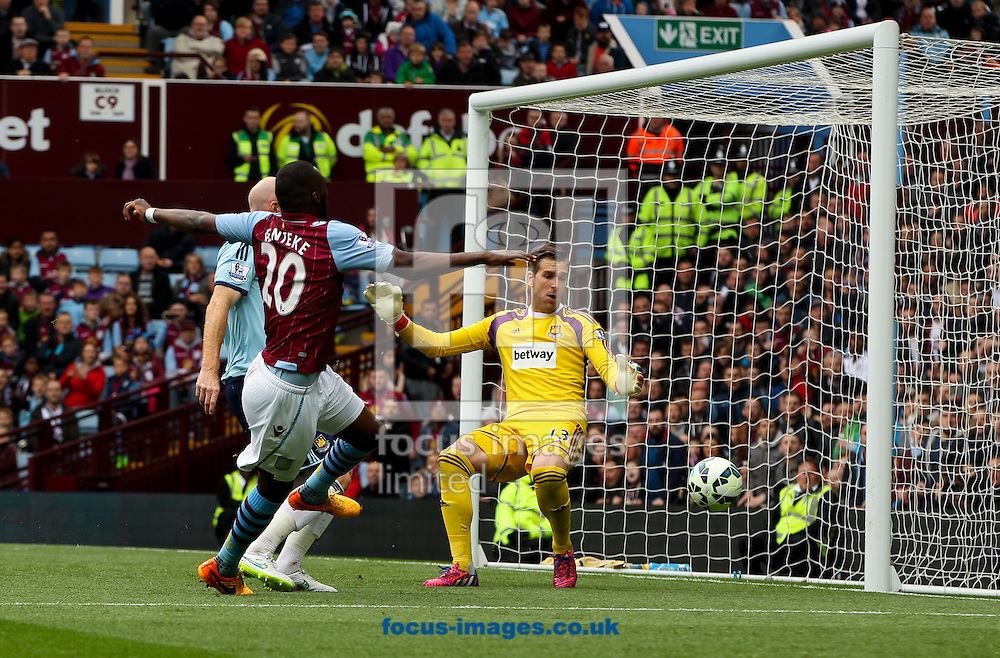 Christian Benteke (left) of Aston Villa puts his shot wide during the Barclays Premier League match at Villa Park, Birmingham<br /> Picture by Tom Smith/Focus Images Ltd 07545141164<br /> 09/05/2015