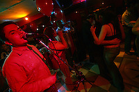 A salsa band plays a show in the Zona Rosa, an area of nightclubs and restaurants in north Bogotá, on October 5, 2007. Salsa is one of the most popular forms of music in Colombia and throughout most of Latin America. (Photo/Scott Dalton)