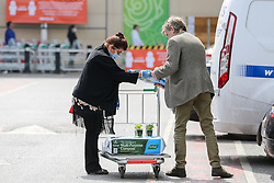 © Licensed to London News Pictures. 27/04/2020. London, UK. Shoppers with compost on a shopping trolley outside Homebase in Haringey, north London which opened today. The lockdown continues to slow the spread of COVID-19 and reduce pressure on the NHS. Photo credit: Dinendra Haria/LNP