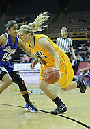 December 20, 2011: Iowa Hawkeyes guard Melissa Dixon (21) drives around Drake Bulldogs guard Brittnye McSparron (24) during the NCAA women's basketball game between the Drake Bulldogs and the Iowa Hawkeyes at Carver-Hawkeye Arena in Iowa City, Iowa on Tuesday, December 20, 2011. Iowa defeated Drake 71-46.