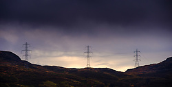 Electricity pylons cross the mountains high above Loch Arklet, Loch Lomond & The Trossachs National Park, Scotland<br /> <br /> (c) Andrew Wilson | Edinburgh Elite media