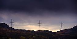 Electricity pylons cross the mountains high above Loch Arklet, Loch Lomond &amp; The Trossachs National Park, Scotland<br /> <br /> (c) Andrew Wilson | Edinburgh Elite media