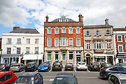 Lloyds Bank Limited building and shops in the Market Place, Devizes, Wiltshire, England