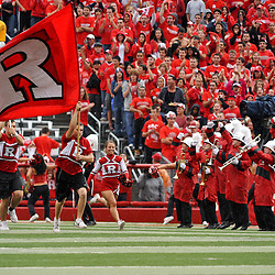 Sep 12, 2009; Piscataway, NJ, USA;  The Rutgers cheerleaders lead the football team onto the field for Rutgers' 45-7 victory over Howard in NCAA College Football at Rutgers Stadium.