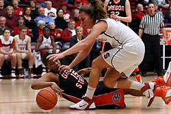 February 24, 2011; Stanford, CA, USA;  Stanford Cardinal guard Jeanette Pohlen (23) grabs a loose ball from Oregon St. Beavers guard/forward Earlysia Marchbanks (15) during the first half at Maples Pavilion.