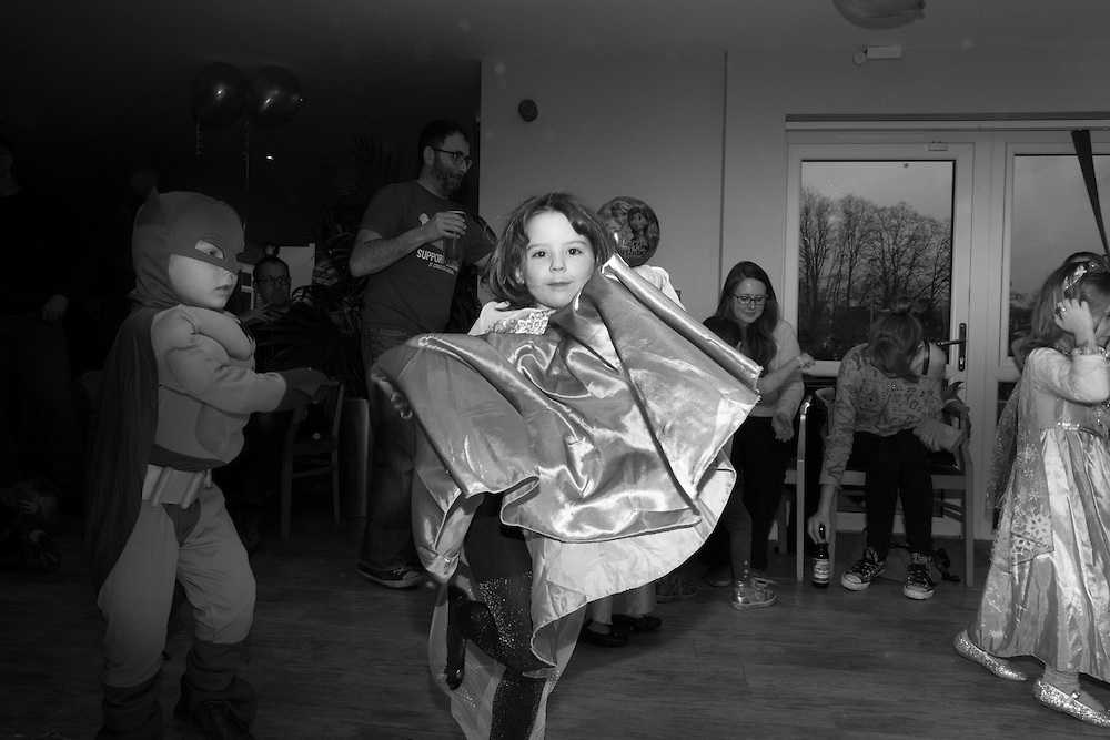 Ben, dressed as Batman, dances with Anya, the birthday girl during a fancy dress party at the tennis club in Berkhamsted, England Saturday, Feb. 14, 2015 (Elizabeth Dalziel) #thesecretlifeofmothers #bringinguptheboys #dailylife