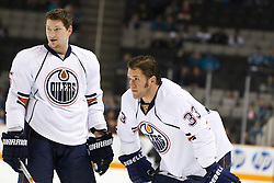 January 13, 2011; San Jose, CA, USA; Edmonton Oilers defenseman Ladislav Smid (5) and left wing Steve MacIntyre (33) warm up before the game against the San Jose Sharks at HP Pavilion.  Edmonton defeated San Jose 5-2. Mandatory Credit: Jason O. Watson / US PRESSWIRE