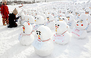Children look at an army of snowmen during the Sapporo Snow and Ice Festival in Sapporo City, northern Japan. Around 2 million people visit the city to see the hundreds of hand-crafted snow and ice sculptures that have graced the Sapporo Snow and Ice Festival since its inception in 1950.