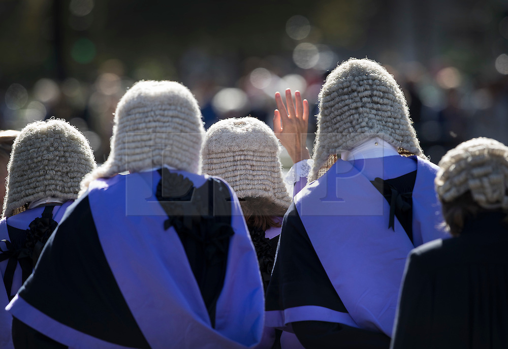 © Licensed to London News Pictures. 03/10/2016. London, UK. A judge waves as she walks with others to Parliament after attending a Service at Westminster Abbey. The Service heralds the start of the legal year in the United Kingdom  - the fourth term of the legal year, known as Michaelmas term. Photo credit: Peter Macdiarmid/LNP