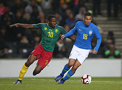 Brazil's Allan (right) and Cameron's Anaud Djoum battle for the ball