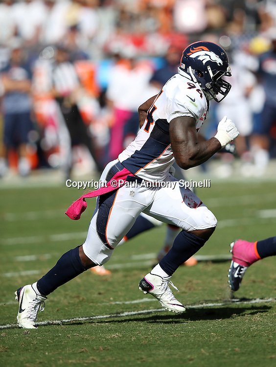 Denver Broncos outside linebacker DeMarcus Ware (94) rushes the quarterback during the 2015 NFL week 5 regular season football game against the Oakland Raiders on Sunday, Oct. 11, 2015 in Oakland, Calif. The Broncos won the game 16-10. (©Paul Anthony Spinelli)