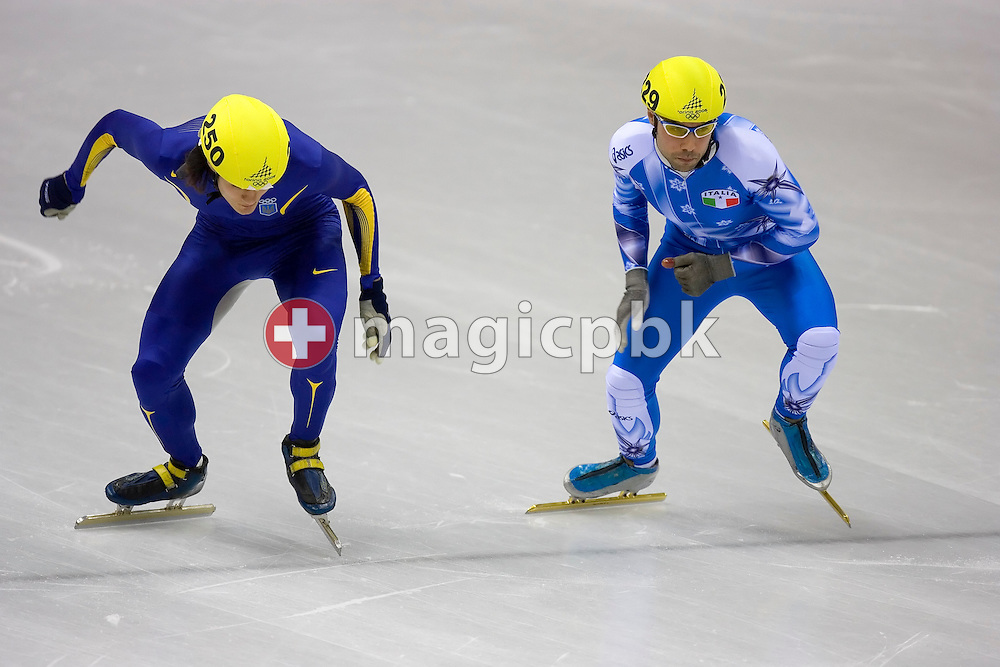 (L-R) Volodymyr GRYGORIEV #250 of Ukraine and  Fabio CARTA #249 of Italy start in the quarterfinal 4 of the short track speed skating on Day 8 of the 2006 Turin Winter Olympic Games on February 18, 2006 in Turin, Italy. (Photo by Patrick B. Kraemer / MAGICPBK)