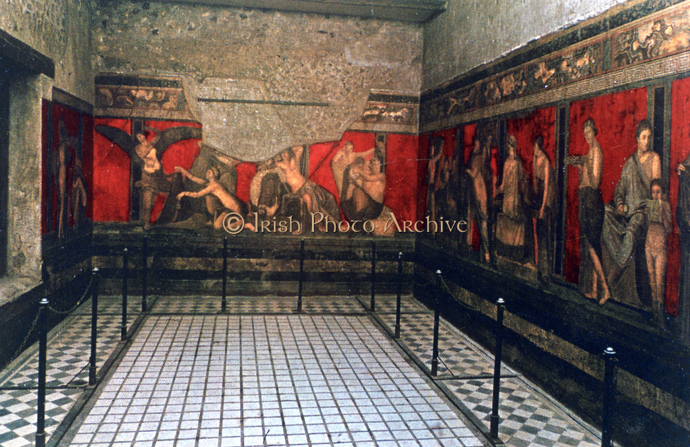 Ritual frescoes in the Initiation Chamber, Villa of the Mysteries, Pompei, Italy.   Ancient Roman