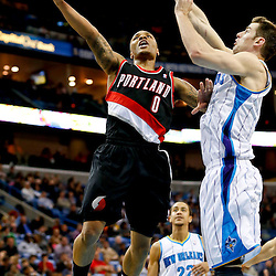 Feb 13, 2013; New Orleans, LA, USA; Portland Trail Blazers point guard Damian Lillard (0) shoots over New Orleans Hornets power forward Jason Smith (14) during the second half of a game at the New Orleans Arena. The Hornets defeated the Trail Blazer 99-63. Mandatory Credit: Derick E. Hingle-USA TODAY Sports
