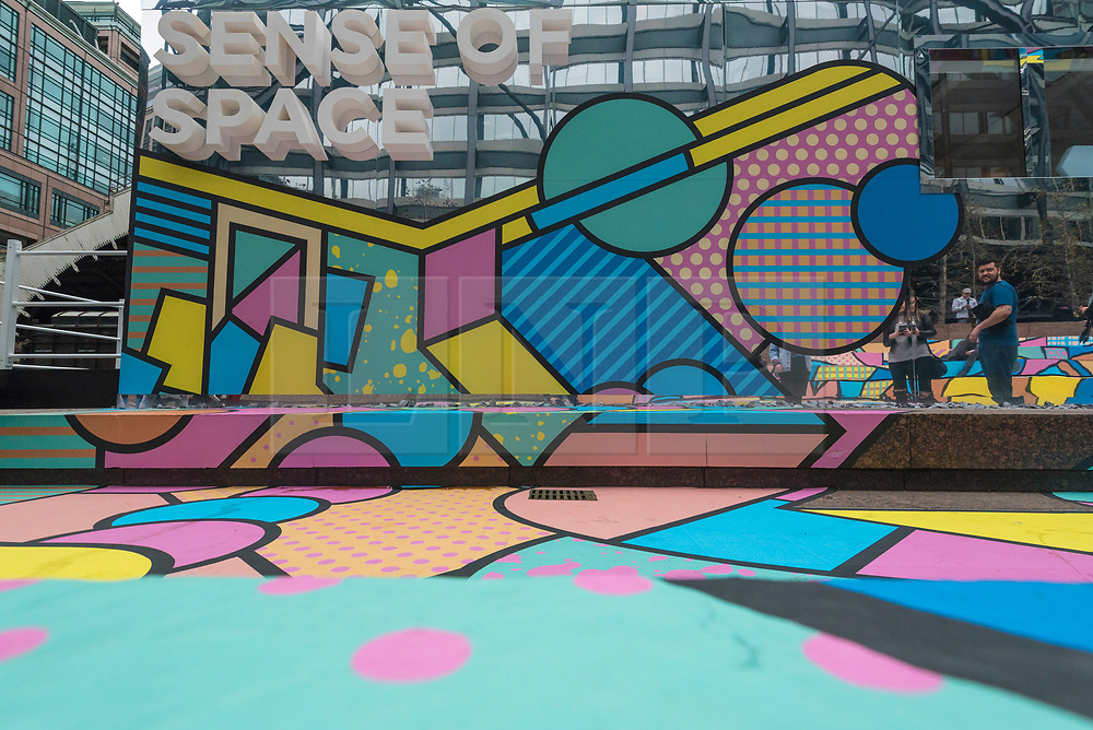 """© Licensed to London News Pictures. 07/04/2018. LONDON, UK.  The colourful entrance mural by graphic designer artist Supermundane outside """"Sense of Space"""", an art pop-up which opened to the public in Broadgate.  Comprising four rooms to challenge the visitor's sensory perceptions through art, the installation is open until 18 May.  Photo credit: Stephen Chung/LNP"""